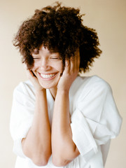 Portrait of smiling mixed race young woman with Afro