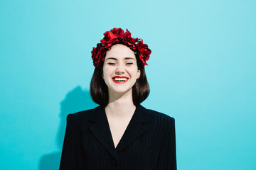 Cheerful woman with flower wreath