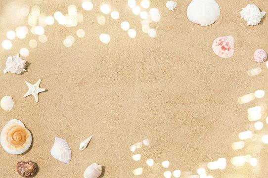 vacation and summer holidays concept - seashells on beach sand