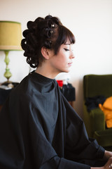 Young woman with rollers in her hair in preparation for a formal event