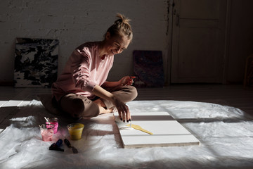 Creative woman enjoying painting