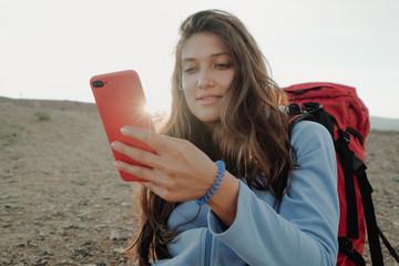 girl traveler uses phone