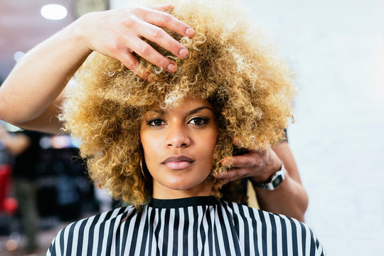 Attractive African-American woman in hairdressing salon