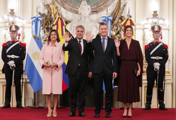 Colombia's President Ivan Duque, his wife Maria Juliana Ruiz Sandoval, Argentina's President Mauricio Macri, and his wife, first lady Juliana Awada, pose for a picture at the Casa Rosada Presidential Palace in Buenos Aires