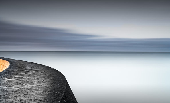 Harbour wall and calm sea