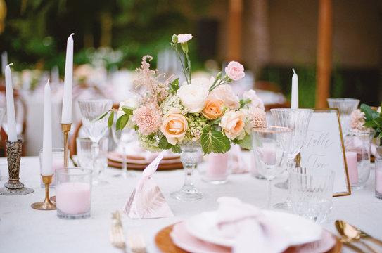 Elegant Outdoor wedding tabletop with florals
