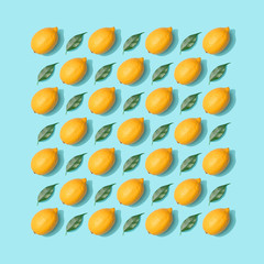 Lemons and leaves pattern on pastel blue background. Minimal nature concept. Fruit flat lay.