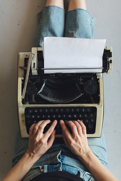 Up view from typewriter on a woman