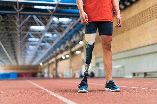 Close up disabled man athlete with leg prosthesis