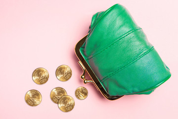 Purse for coins.Wallet for change. Leather purse, purse on a pink background. Color of the trend.The concept of poverty