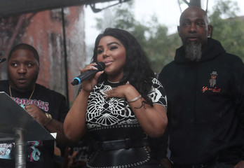 """Rap singer Lil' Kim speaks at the street naming ceremony for Christopher """"Notorious B.I.G"""" Wallace way in the Brooklyn borough of New York"""