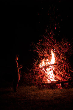 Silhouette of girl against the background of a fire flame