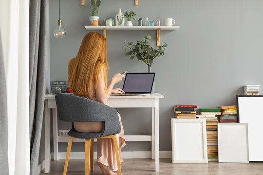 Redhead woman working at home