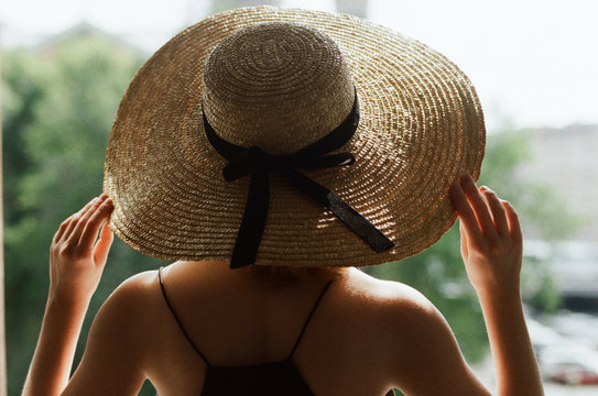 Back view of a woman with straw hat