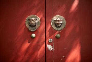 Aged old mahogany door in the alley of Beijing