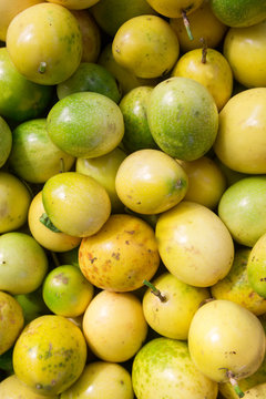 Bin of organic, fresh passionfruit
