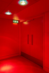 Exit door and Fire exit sign in a red room