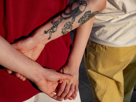 The hands of the couple in love gently squeeze each other
