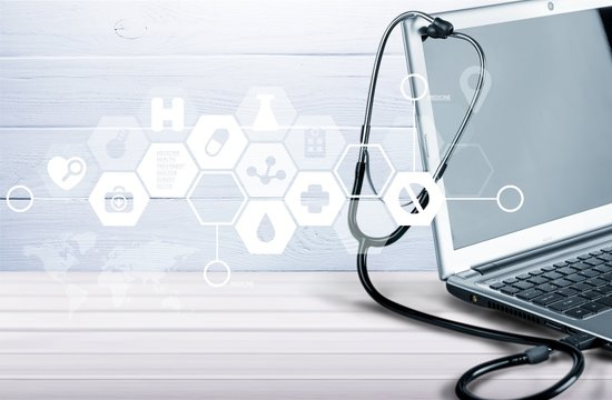 Laptop diagnosis with  stethoscope  on background