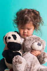 Little kid with stuffed animals