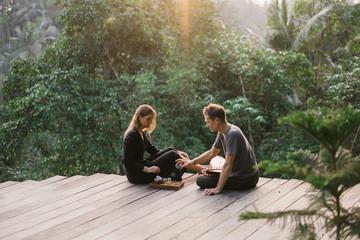 Couple having tea on exotic terrace