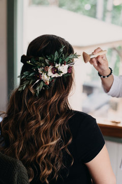 Blush being applied to Bride