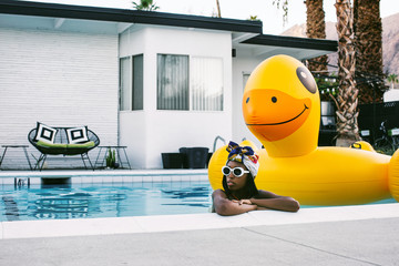 Young Stylish Black Woman in Swimming Pool with Large Smiling Du