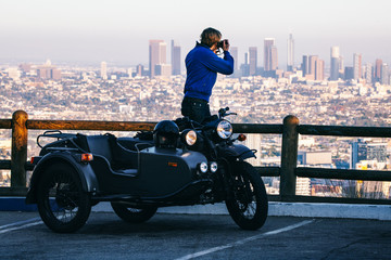 Anonymous Young Blond Hipster Taking Photo of Downtown Los Angel