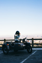 Anonymous Young Man Sitting on Motorcycle and Taking Photo of Do