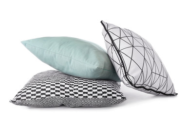 Stylish pillows on white background