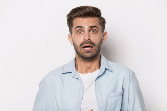 Guy feeling shortness of breath about emotional stress studio headshot