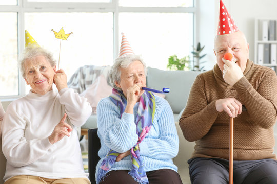 Happy senior people spending time together in nursing home