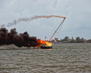 Sailboat on fire — Mast is falling