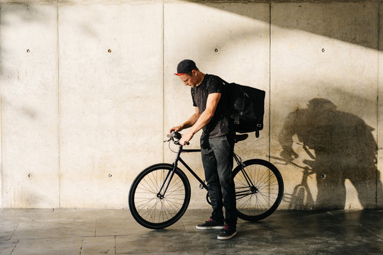 Man with delivery bag and bicycle