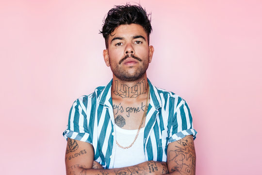 Serious tattooed man with mustache