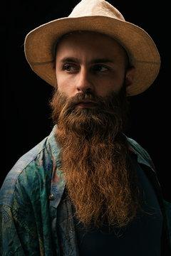 Young man with beard looking at camera