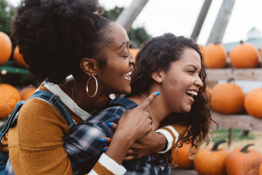 Two friend at a pumpkin patch at halloween