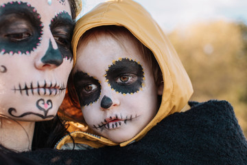 Headshot portrait of mother and son with halloween make up