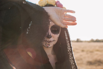 Halloween portrait of woman with scull make up