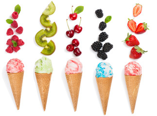 Wall Mural -  Flat lay concept waffle ice cream cones and fresh berries.