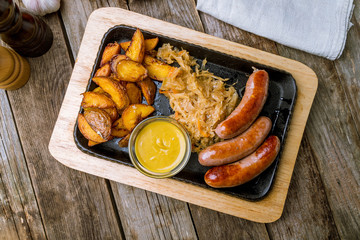 Aluminium Prints Grill / Barbecue fried pork sausages on the Board