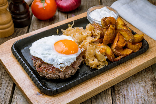 beef steak with egg and cabbage and potatoes