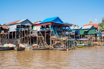 The floating village on the water (Komprongpok) of Tonle Sap the largest freshwater lake in Southeast Asia, Siem Reap, Cambodia.  Wall mural