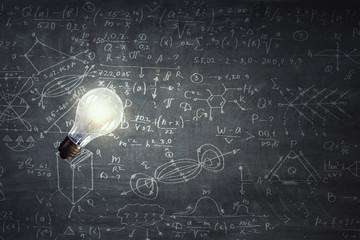 Light bulb on chalk board background