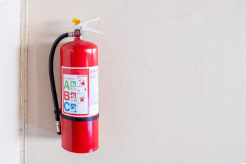 Fire extinguisher system on the wall background, powerful emergency equipment for industrial