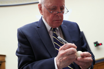 Former White House counsel Dean signs a golf ball once purportedly used by former President Nixon after testifying about the Mueller Report before a House Judiciary Committee hearing on Capitol Hill in Washington