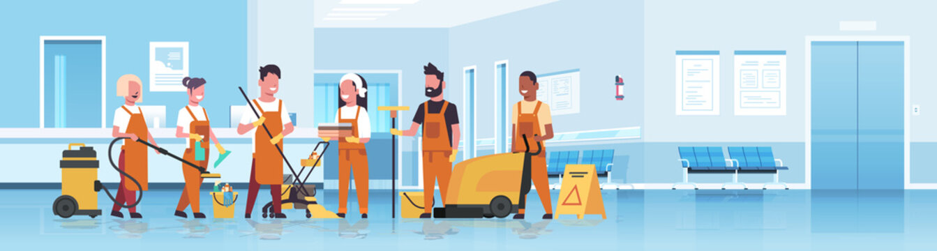 janitors team cleaning service concept mix race cleaners in uniform working together with professional equipment hospital reception interior flat full length horizontal copy space