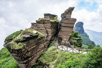Eagle beak rock formation in Fanjing mountain with view of the new golden summit in background Guizhou China