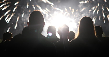 Crowd watching fireworks and celebrating new year eve