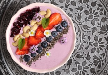 Blueberry strawberry smoothie bowl.